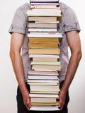 Livros carreg da pessoa Fotos de Stock