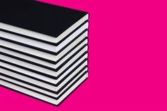 Livros com tampa preta Fotografia de Stock