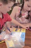 Livros de coloração das crianças junto playfully imagens de stock royalty free