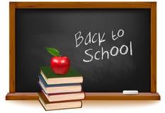 Livros de escola com a maçã na mesa. Foto de Stock