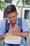 Livros de And Laughter With do estudante masculino fotos de stock royalty free