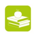 Livros do contorno com a maçã vermelha na parte superior Foto de Stock