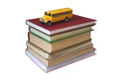Livros e barramento amarelo Fotografia de Stock Royalty Free