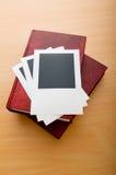 Livros e fotos em branco Foto de Stock