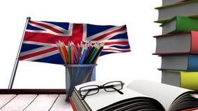Livros e lápis na tabela de madeira filme
