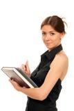 Livros e livros de texto da preensão da mulher em sua mão Imagem de Stock