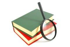 Livros e lupa Fotos de Stock Royalty Free