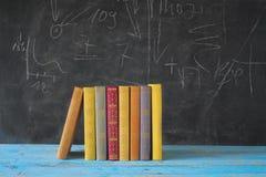 Livros e placa preta Fotografia de Stock Royalty Free