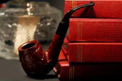 Livros e tubulação Imagens de Stock Royalty Free