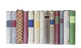 Livros em uma fileira, espaço da cópia isolada, livre fotos de stock