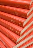 Livros vermelhos empilhados fotografia de stock royalty free
