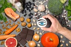 Livsmedelsprodukter som är användbara för vision Arkivfoto