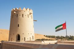 Liwa Fort With UAE Flag. LIWA CRESCENT, UAE - FEBRUARY 15, 2008: The ramparts of a fort situated against dunes in the Liwa Crescent area of Abu Dhabi in the UAE royalty free stock images
