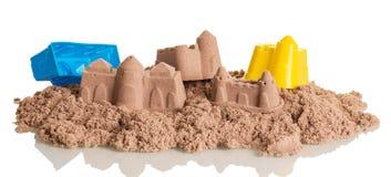 Lixe castelos de cinético e dos brinquedos isolados no branco imagem de stock