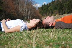 Liying. Young couple liying on grass Stock Photography