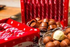 Lizaki i czekoladowi cukierki obrazy royalty free