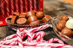 Lizaki i czekoladowi cukierki fotografia royalty free