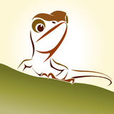 Lizard. Brown head held up standing on a green hill Royalty Free Stock Photos