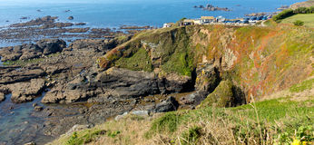 The Lizard peninsula Cornwall England UK south of Helston in summer on calm blue sea sky day Stock Photos