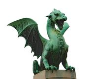 Ljubliana Bridge Dragon - Isolated. Statue of a dragon (the Ljubliana City Emblem) guarding the Ljubliana Dragon Bridge in Slovenia.  Isolated on white Royalty Free Stock Images