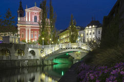 Ljubljana. At night, with the Triple Bridge and Franciscan Church, Slovenia Stock Image