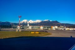 Free Ljubljana Airport With Tarmac, Terminal And Mountains In Background Stock Image - 135402691