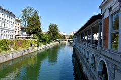 Ljubljana city center and river Ljubljanica. By day when tourists and citizens sitting in the restaurants and cafe next the river Stock Photo