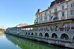 Ljubljana city center and river Ljubljanica. By day when tourists and citizens sitting in the restaurants and cafe next the river Stock Images