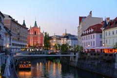 Ljubljana city center. Slovenia Ljubljana Tromostovje Ljublianica river Church stock photos
