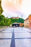 Ljubljana city street, look to castle on the hill. Tourism in the Slovenia capital. royalty free stock image
