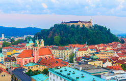Ljubljana cityscape. City of Ljubljana with castle on top of hill, beautiful church and buildings in old medieval town of Slovenia, Europe Royalty Free Stock Images