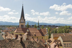 Ljubljana cityscape with roof tiles, Slovenia. Ljubljana cityscape with roof tiles and St. James Church clock tower. Aerial view, Slovenia Royalty Free Stock Photos