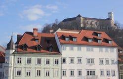 Ljubljana facades and the castle. Urban buildings and the castle on the hill in the background, Ljubljana, Slovenia Stock Photos