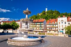 Ljubljana fountain and castle colorful view stock images