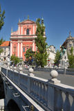 Ljubljana with main bridge tromostovje and a church Royalty Free Stock Image