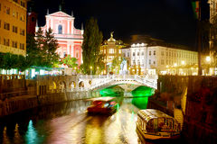 Ljubljana at night. Triple Bridge and Franciscan Church at night. Ljubljana, Slovenia Stock Photography