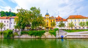 Ljubljana old town center, view of Ljubljanica river in city center. Old building historic panorama. Look to old bridge with touri royalty free stock photography