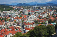 Ljubljana panorama, Slovenia. Panoramic view from the castle of Ljubljana with the Pink Church and distant Alps, Slovenia Stock Images