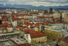 Ljubljana Rooftops. Drone shot of the rooftops of downtown Ljubljana city in Slovenia. Mountains bordering Italy in the distance Stock Images