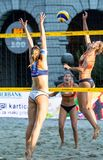 Beata Vaida from Romania attacking on the net as Anni Schumacher from Germany is about to block. Ljubljana, Slovenia - JULY 22, 2017: Beata Vaida from Romania Stock Images
