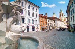 Ljubljana, Slovenia - June 7, 2016 Robba's fountain in the foreground and St. Nicholas church in the background Royalty Free Stock Photos