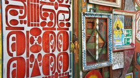 Ljubljana, Slovenia - 07/19/2015 - Part of art wall in Metelkova, artistic district with colored buildings, graffitti, sculptures stock photos