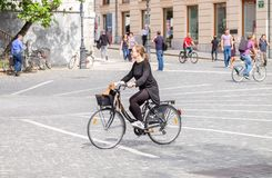 Beautiful blonde girl ride on bicycle on central square in Ljubljana, the capital of Slovenia. LJUBLJANA, SLOVENIA - SEPTEMBER 04 , 2018: Beautiful blonde girl royalty free stock photography