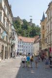 Ljubljana, Slovenia. Tourists walking in the romantic medieval city Ljubljana, the capital of Slovenia Royalty Free Stock Image
