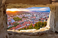 Ljubljana sunset through stone window aerial view. Capital of Slovenia Royalty Free Stock Image