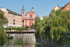 Ljubljana with wooden bridge tromostovje and a church behind Stock Photography