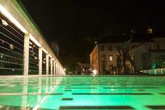 Ljubljanica bridge in Ljubljana at night. Ljubljanica bridge and statue in Ljubljana at night Royalty Free Stock Photography