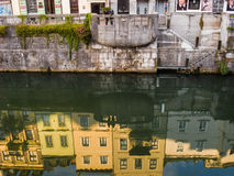 Ljubljanica. Buildings are reflected in the river Ljubljanica in the center of Slovenian capital Ljubljana, one of the emerging travel destinations in South East Royalty Free Stock Photo
