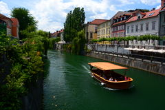 Ljubljanica River. Ljubljana. Slovenia. Ljubljana is the capital and largest city of Slovenia. Located in the middle of a trade route between the northern Stock Photos