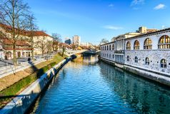 Ljubljanica river with old central market and Dragon bridge, Lju. Bljana. View from Butchers` bridge at Plecnik`s Covered Market by famous architect Joze Plecnik Royalty Free Stock Photography